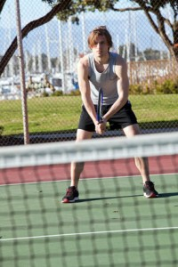 Young man ready to return a tennis serve